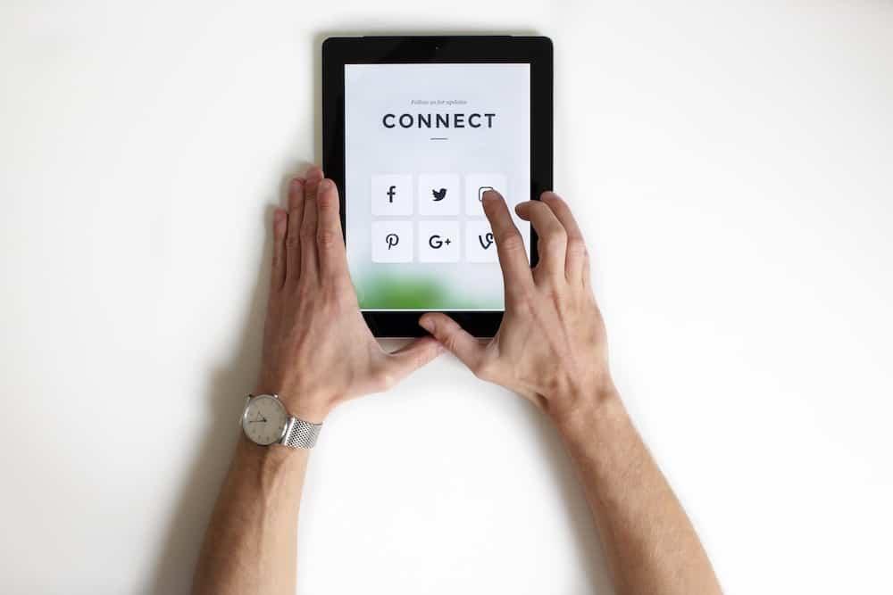 person using black iPad