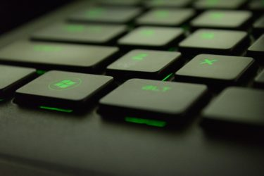 Windows Button on a Backlit Green Keyboard