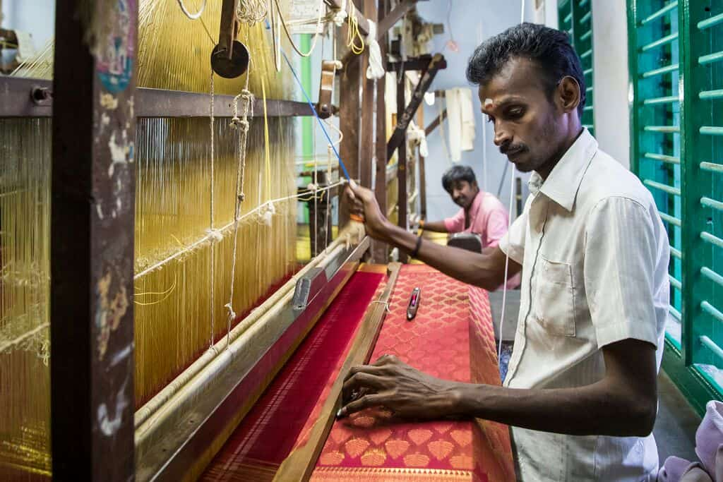 guy making silk sarong