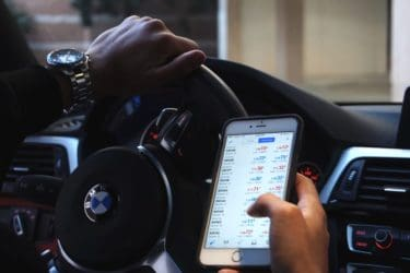Man Trading Forex in His BMW