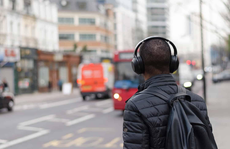 a guy listen on headphone