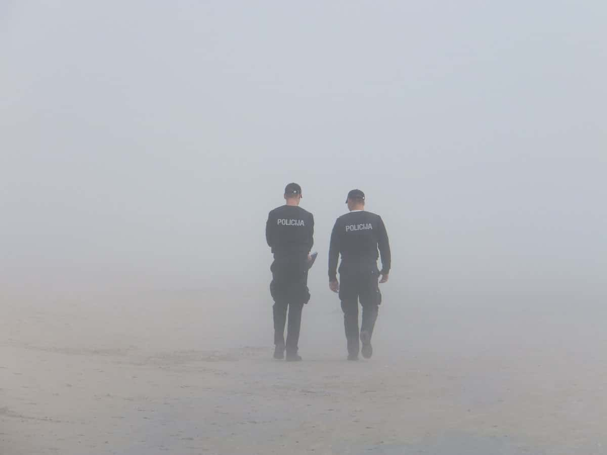 police walking into Fog