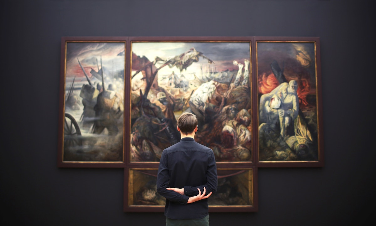 Man enjoying paintings at an art gallery