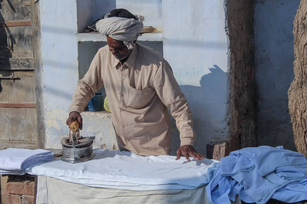Indian Man Ironing