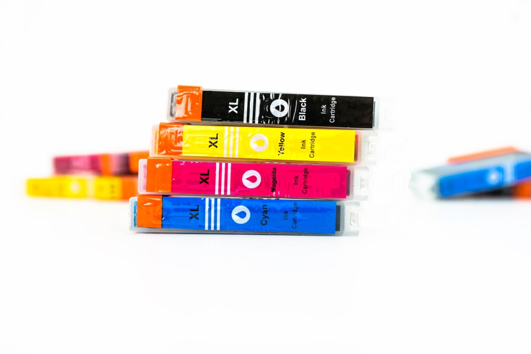 close-up-shot-of-a-cmyk-ink-cartridges-for-a-color-printer-isolated-on-a-white-background-printer