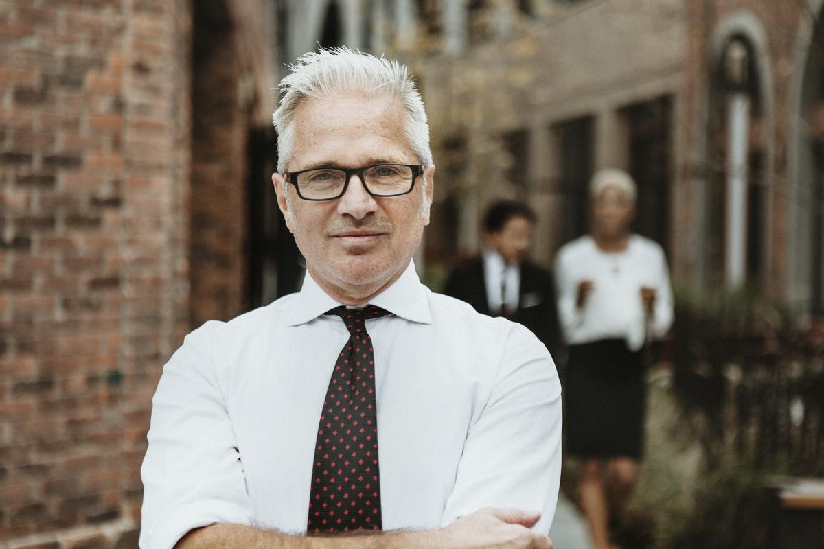 Confident mature businessman in the city