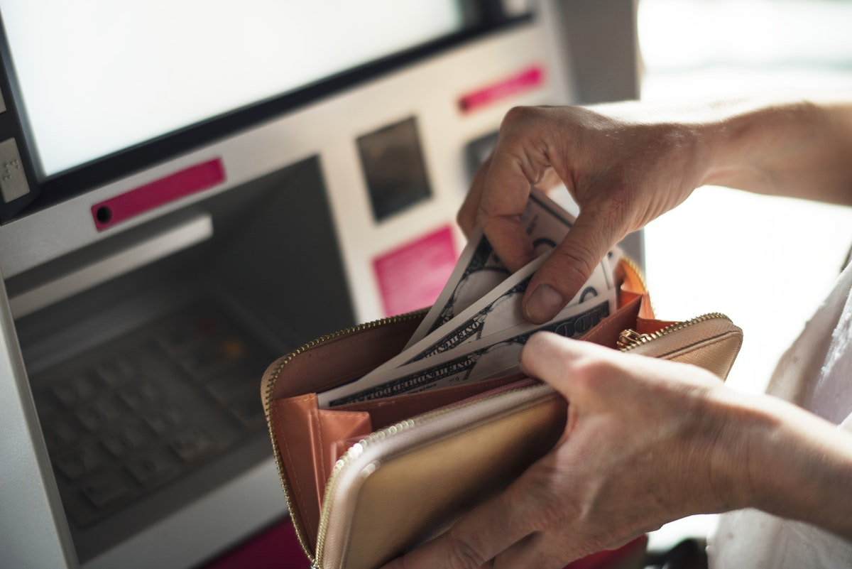 An Adult Woman Hands With Cash Money at ATM