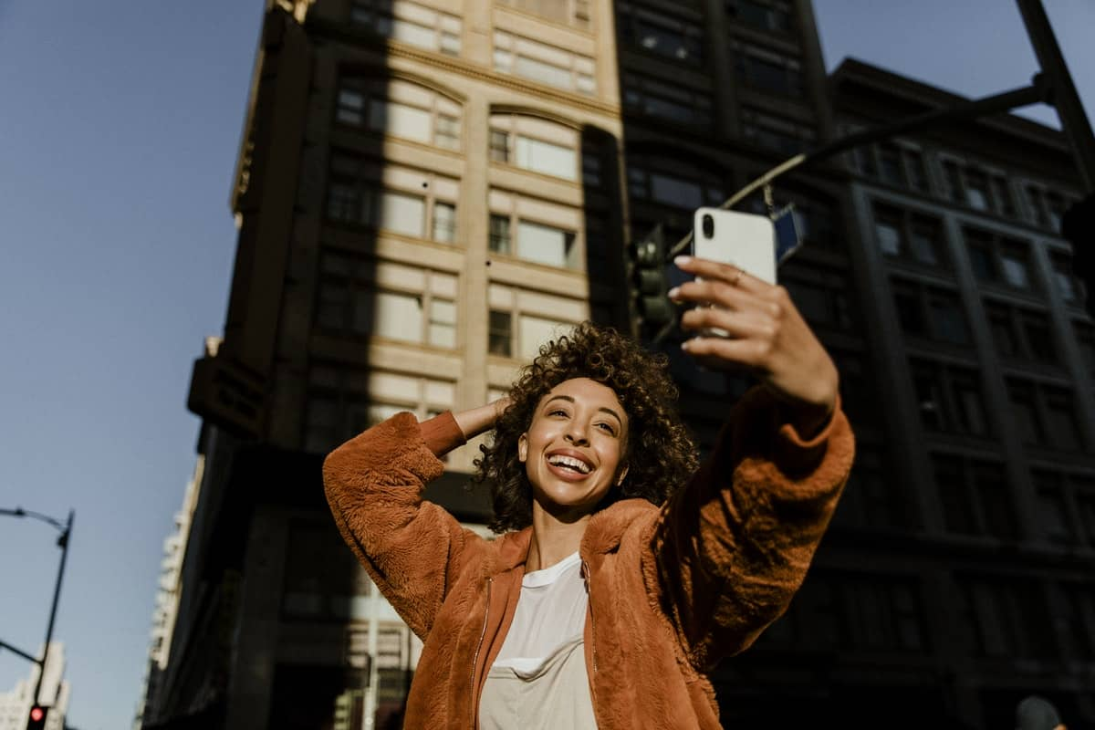 Black female blogger taking a selfied during sunset
