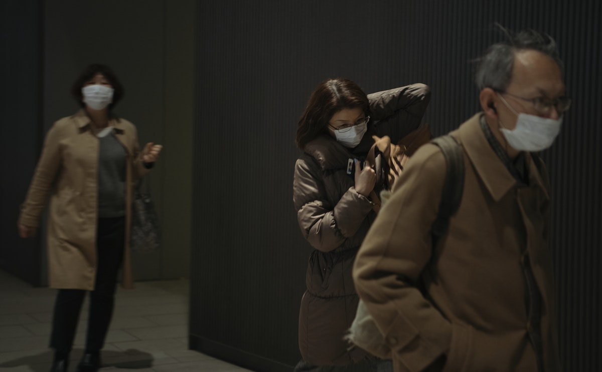 Commuters wearing disposable masks