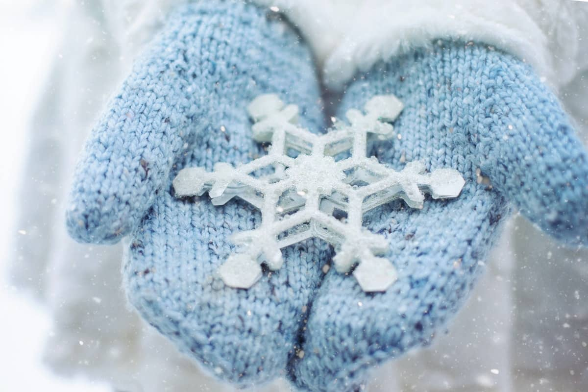 Girl Holding a Massive Snowflake