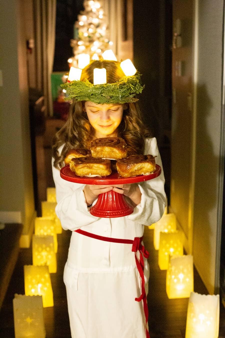 A girl in Swedish costume celebrating Santa Lucia day