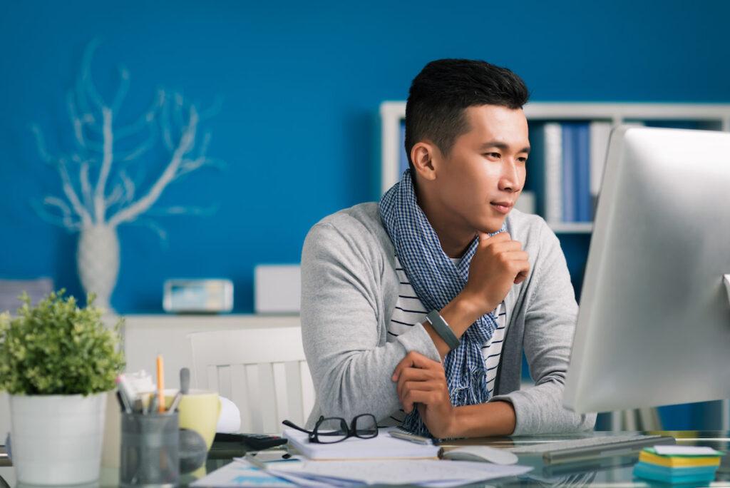 Man Looking at a Desktop Imac